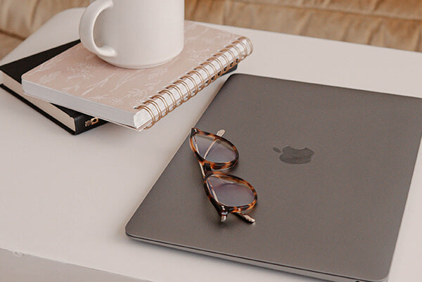 A pair of glasses on the computer