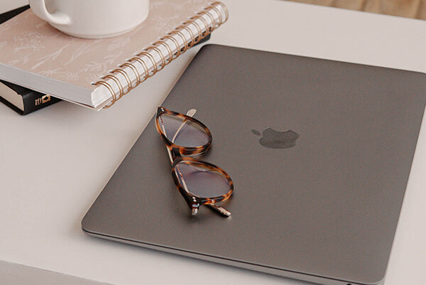 There is a pair of glasses on the computer