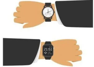 Right hand showing digital watch and left with an analog watch.