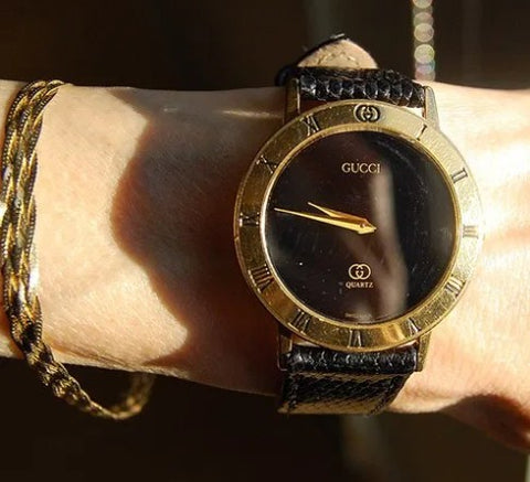 Wearing Gucci watch