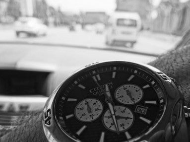 Driver showing off their Citizen Chronograph.