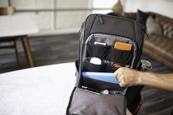 How do I travel with a laptop safely in my backpack
