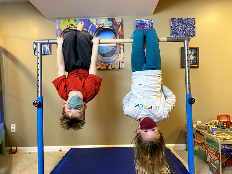 A Boy and a Girl Exercising with a Gymnastics Bar with Solid Wood Bar