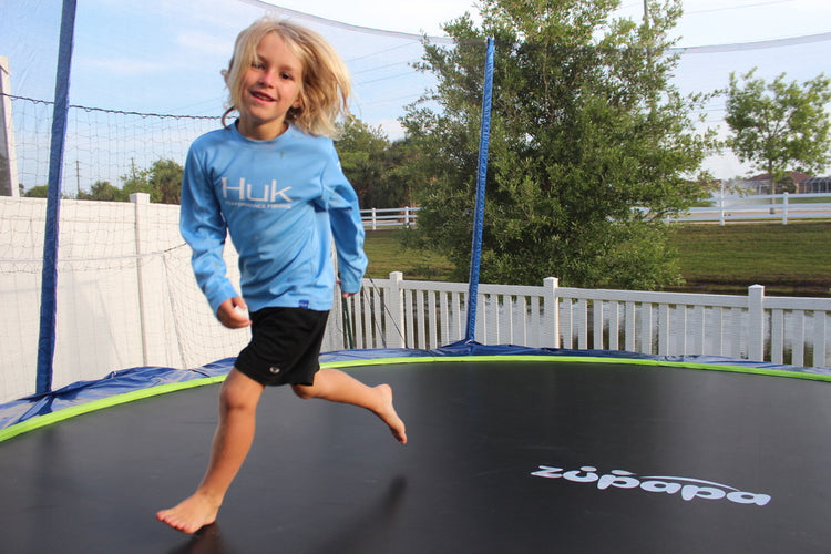 a girl on a Zupapa outdoor trampoline