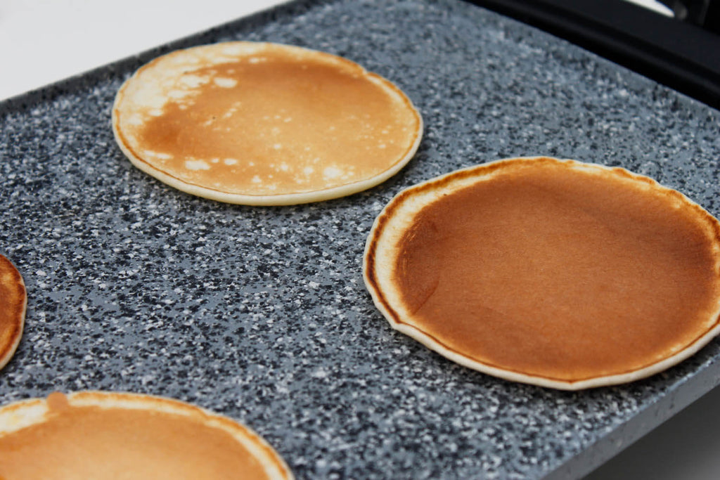 Cooking pancakes on Atgrills gray electric griddle