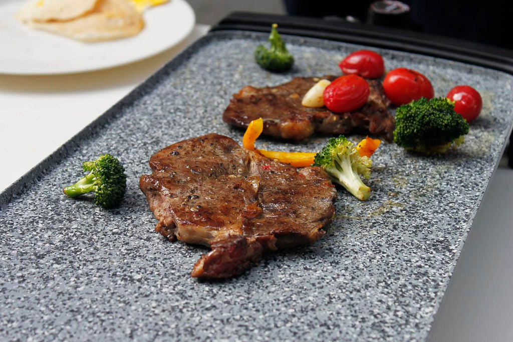Gray griddle with food
