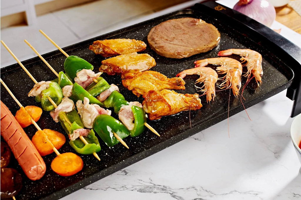 Grill griddle with burger, sausage, shrimp and chicken