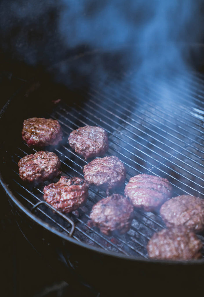 Grilling food on charcoal grill