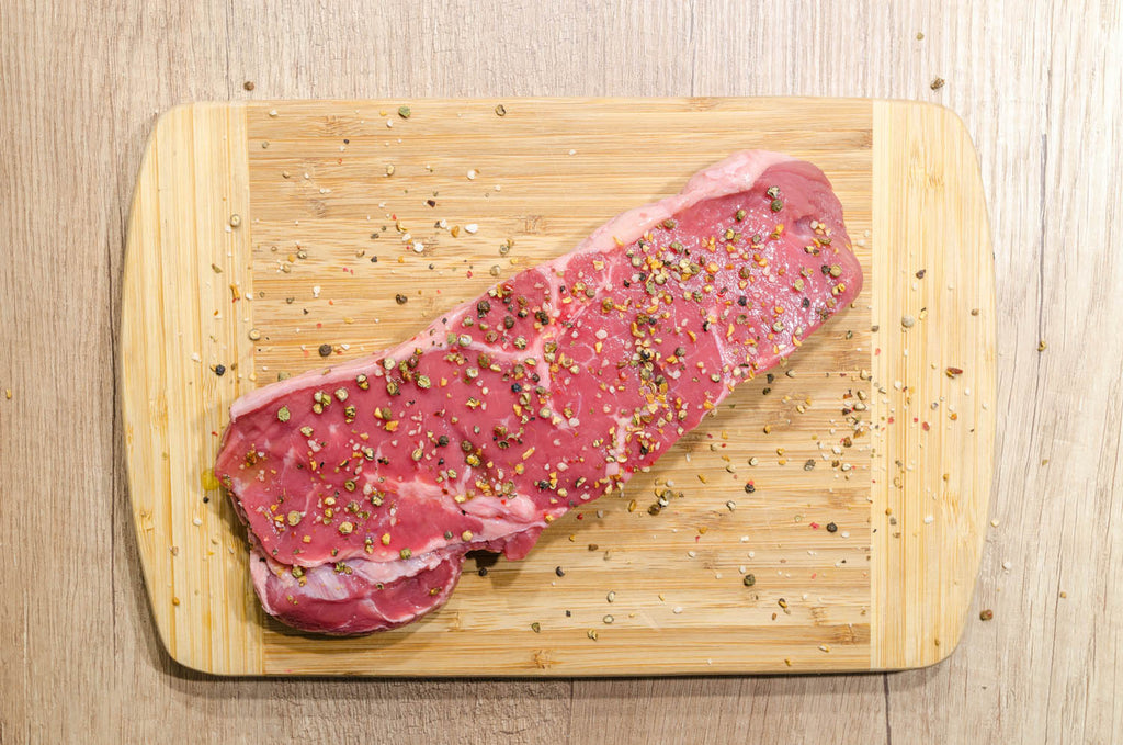 Slice of meat on chopping board
