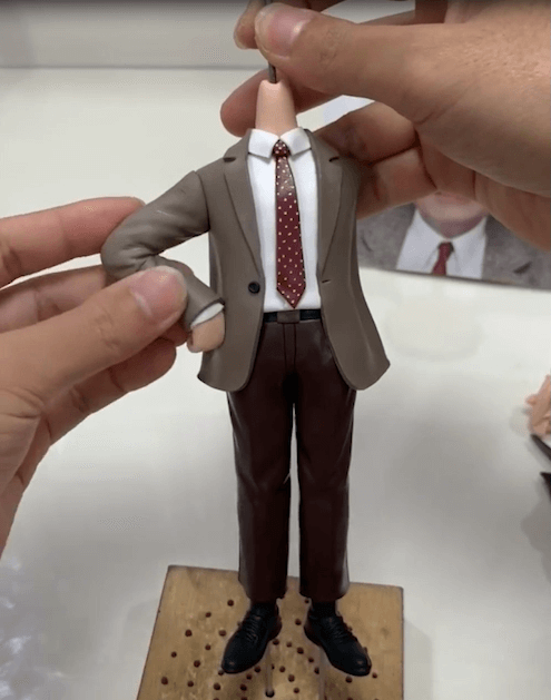 Connect his arm of the bobblehead