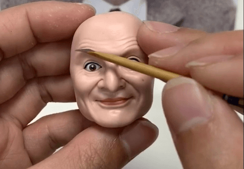 draw his eyebrow of the bobblehead