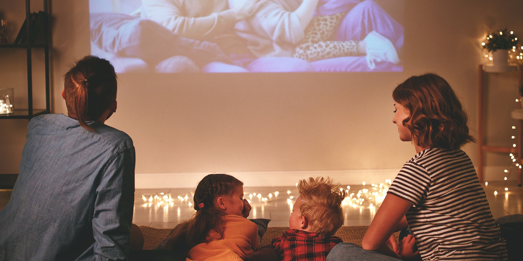 a family gather together to have a home movie party