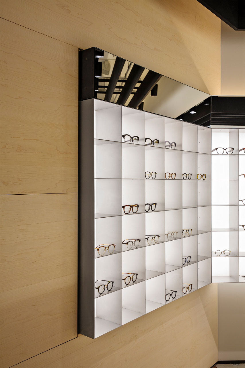 gentle monster optical store wall mount display cabinet