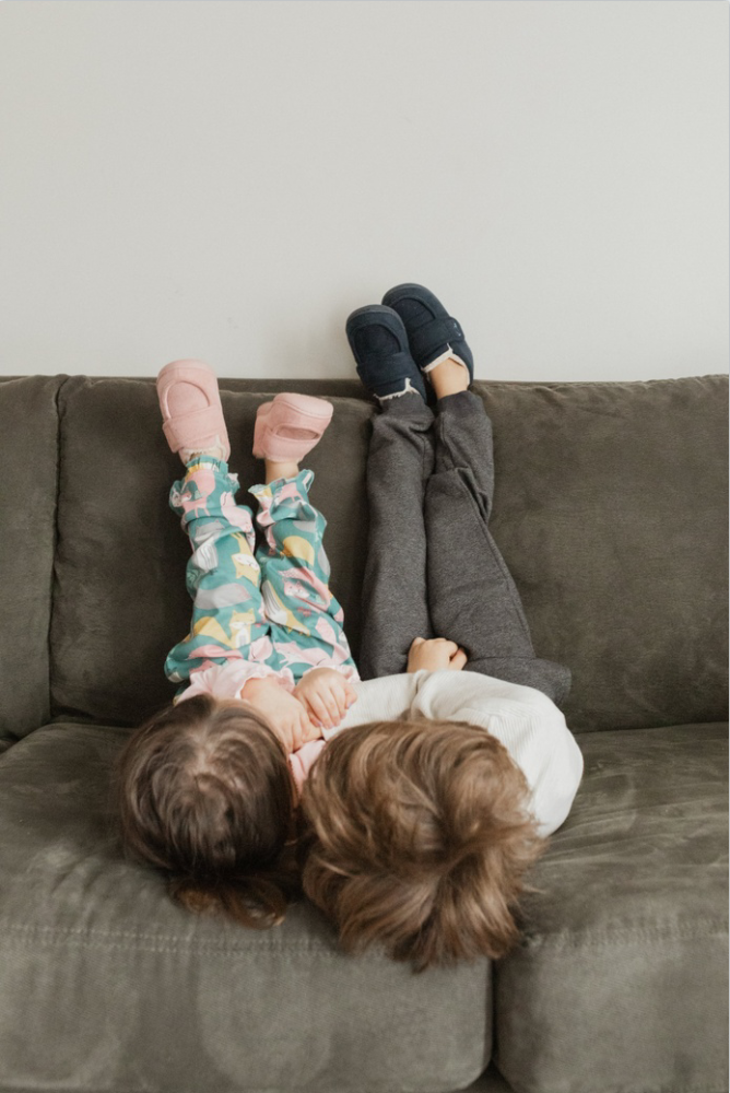 Two kids playing in slippers