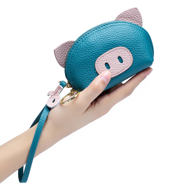 himoda cute leather coin pouch-piggy- blue in hand