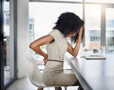 back pain while sitting down