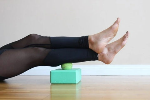 put tennis balls on yoga bricks