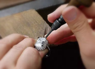 Adjust the diamond claws on the ring with an awl