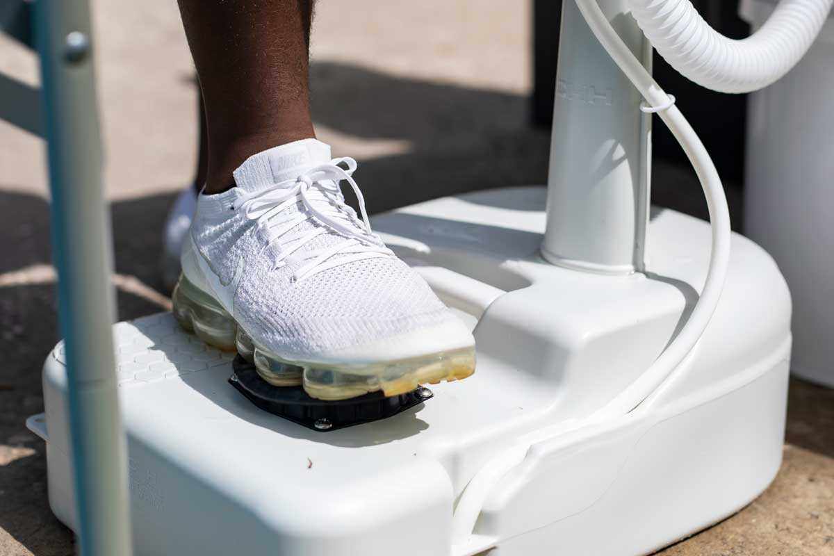 portable hand washing station with foot pump