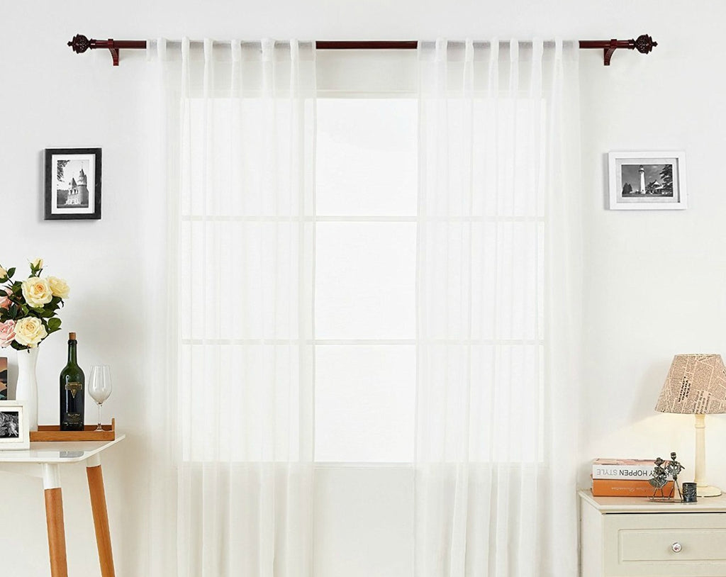 white voile curtains by art on white wall