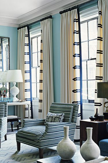 plain white lamps and light blue and white curtains.