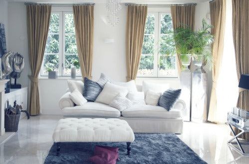 Window treatments embellish the look with natural fibers such as silk, linen and brocade. Large antique area rugs define spaces within a room. Glass and crystal lighting complement the look. The space is ordered, cohesive and comfortably elegant.