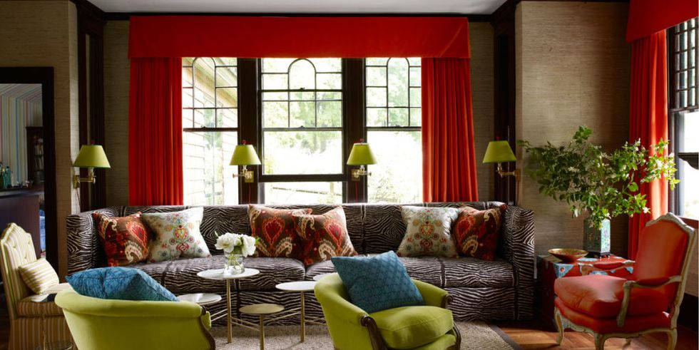 Expanses of red curtains and deep valances let the windows make the color statement