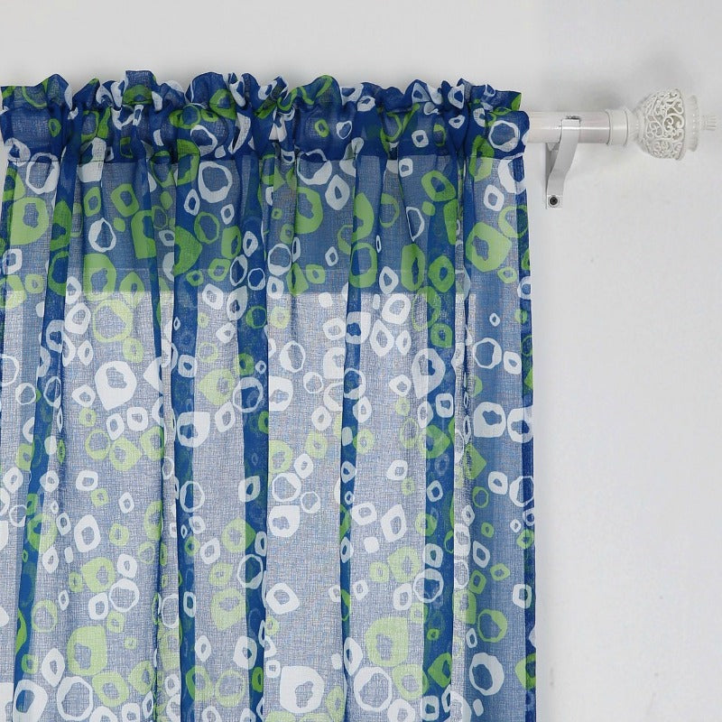 colorful purplish curtains with circular colored shapes