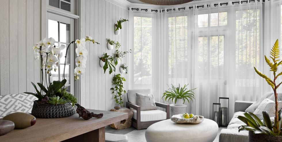 contrast of the dark eyelet rings and dark rods with the white of the curtains.