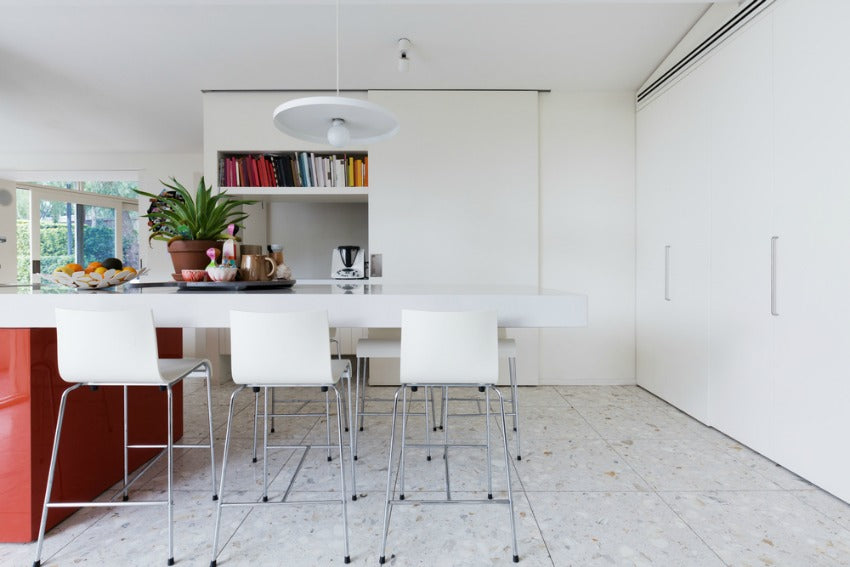floors & ceiling of a white kitchen table surrounded by chairs