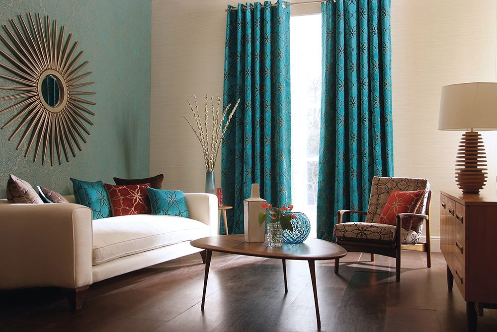 turquoise curtains set the color scheme and command the eye to the window.
