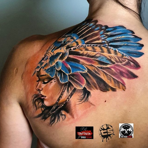 tribal feather tattoo on the back