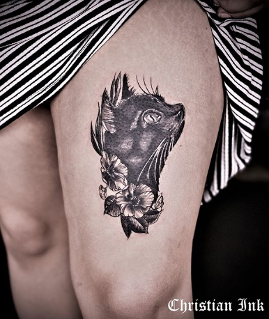 black cat thigh tattoo