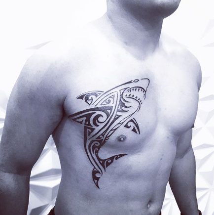 tribal shark tattoo on the chest