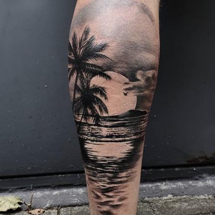 Large Size of Beach Tattoo on the calf