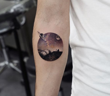 tattoo of universe in a circular frame