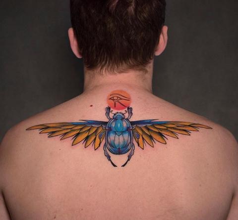 scarab tattoo on the upper back