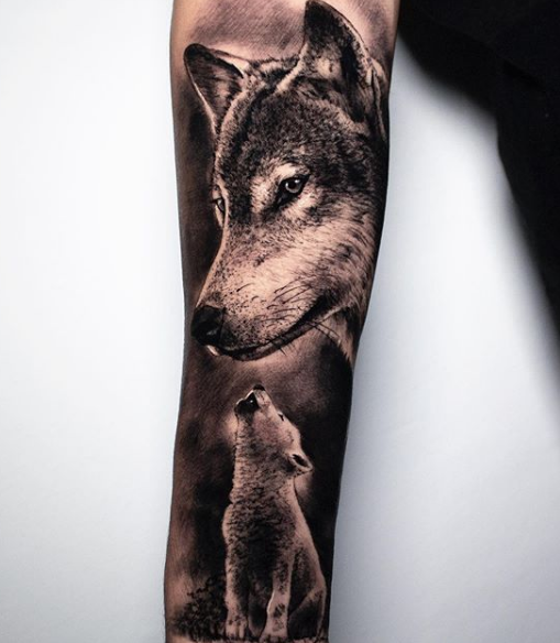 wolf and pup sleeve tattoo on arm