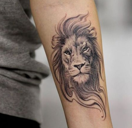 lion tattoo on the forearm