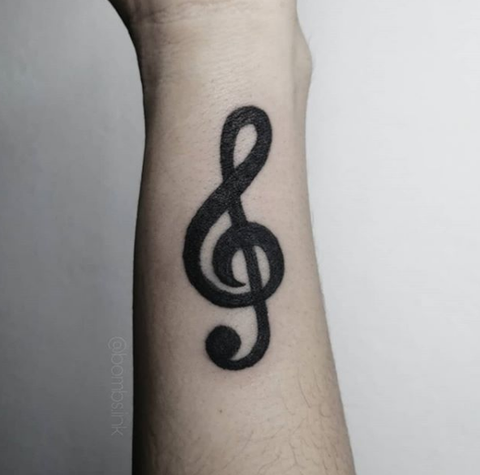 music note forearm tattoo