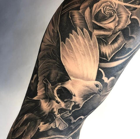 rose and dove sleeve tattoo