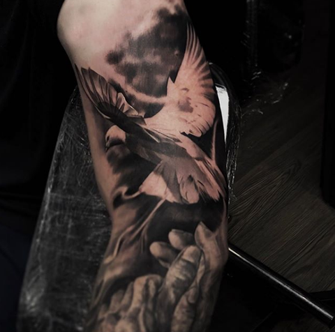 flying dove sleeve tattoo