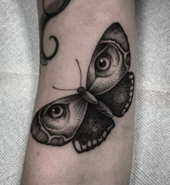 butterfly and eye tattoo