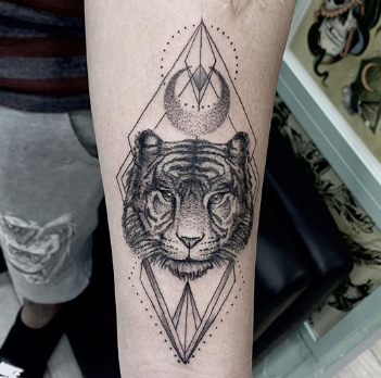 linear tiger tattoo on forearm