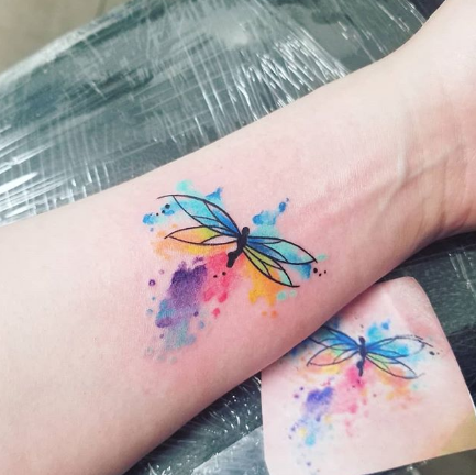watercolor dragonfly forearm tattoo