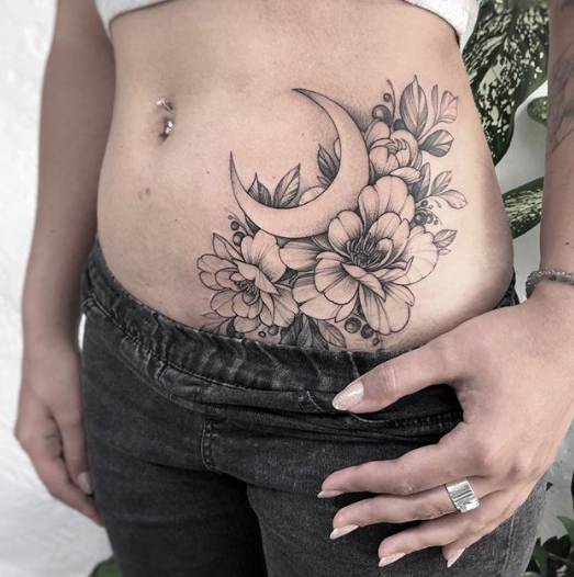 moon and flower stomach belly tattoo