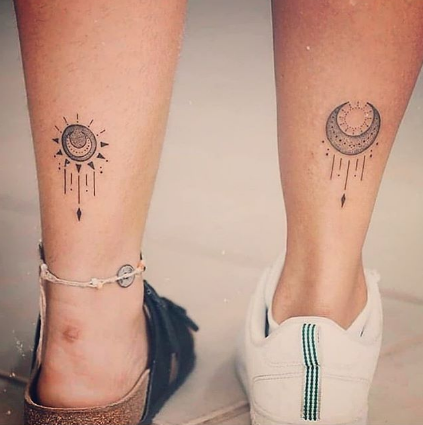 matching couple sun and moon tattoo