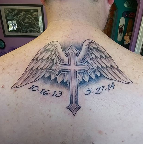 Cross Tattoo With Wings on back