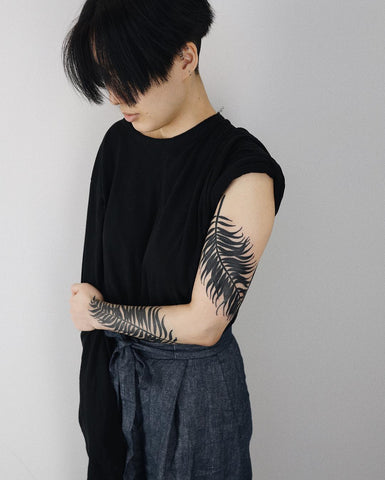 plant leaf tattoo on arms