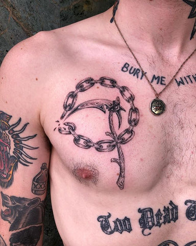chain sickle tattoo on the chest